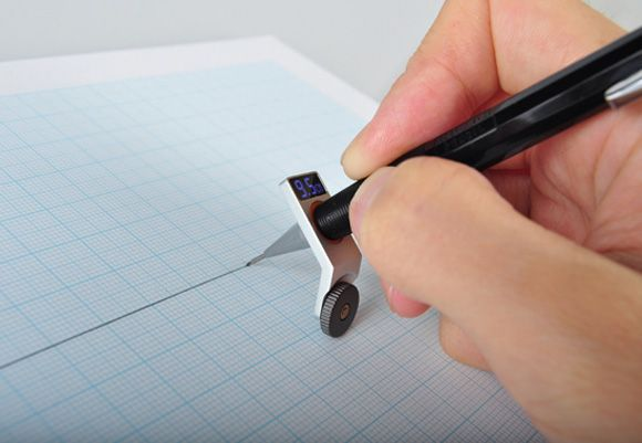 Constrained Ball.   When attached to a pen or pencil helps you draw a straight line. Also measures the distance of the line drawn.