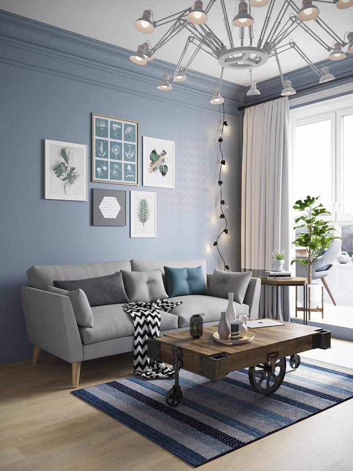 Salon Style Scandinave Avec Le Bleu Et Le Gris Tres Present La Magnifique Table Basse Diy Et Le Lustre De Deco Maison Deco Salon Scandinave Decor Salon Maison