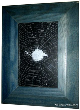 how to preserve a spider web using spray paint and spray adhesive to mount the spider web on card stock before placing in a picture frame