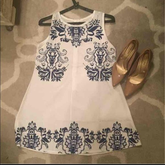 "Sheer White Floral Dress/Top Sheer material, dark blue floral pattern, can be worn as a top or dress. 29"" from top of dress to bottom Dresses Mini"