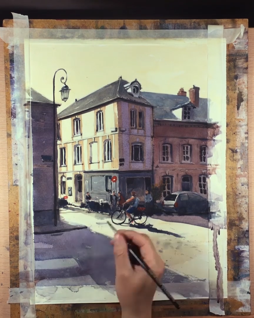 Watercolor painting of a cyclist riding past the pizzaria on a hot summer day. This artwork is titled