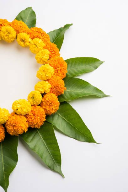 Flower Rangoli Made Using Marigold Or Zendu Flowers And Mango Leaves Diy Diwali Decorations Flower Rangoli Diy Wedding Decorations