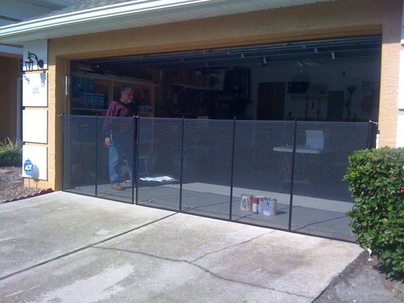 Black pool fence installed across garage door. | Orlando, Florida ...