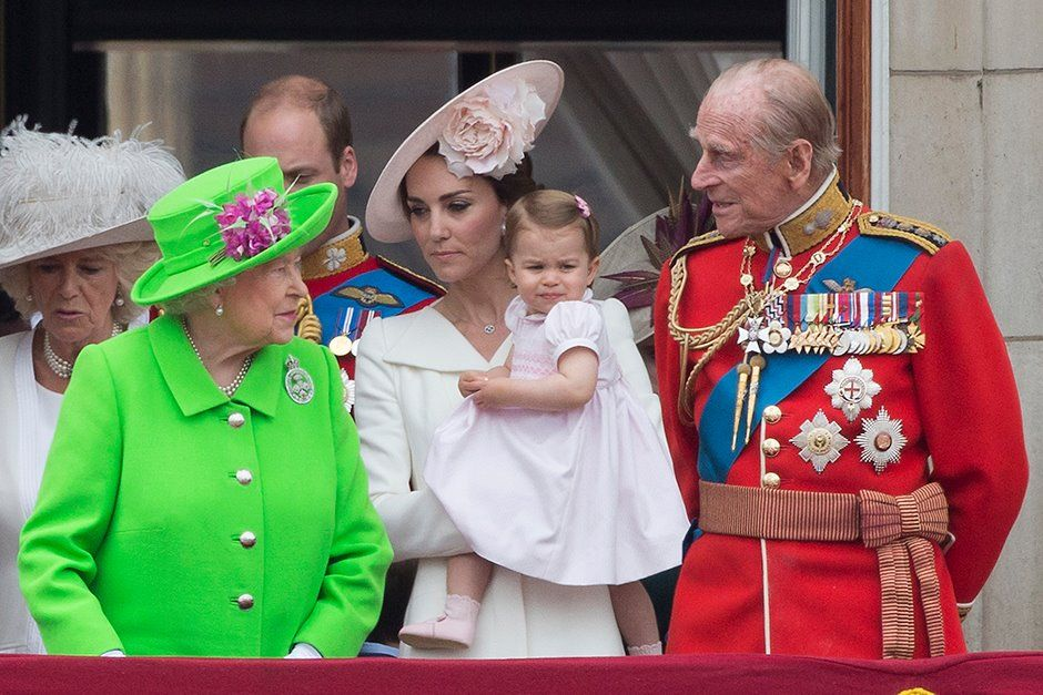 Princess Charlotte Makes Her First Appearance On The Royal Balcony as The Queen and the Royal Family gather on the balcony of Buckingham Palace for Royal Air Force birthday flypast