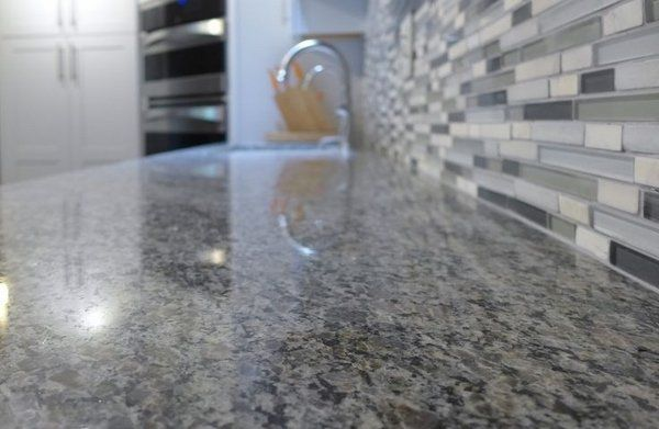 how to choose kitchen countertops new caledonia granite countertop glass tile backsplash - How To Choose Kitchen Backsplash