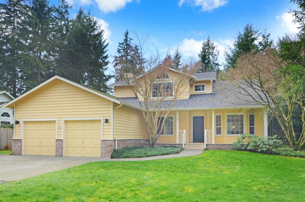 SOLD - This Poulsbo home features 3 beds + den/office, 2.5 baths, & 1,852 SqFt all on 1.22 serene acres. Enjoy chic hardwoods/spacious kitchen/formal & informal dining areas/vaulted ceilings & cozy wood stove. Relax in the luxurious master suite w/ 5-piece tiled bath & walk-in closet, on the covered front porch, large back deck, or in the enchanting gardens. Just minutes from local schools, amenities & transportation, this home is the complete package! 17667 Noll Rd NE, Poulsbo WA 98370