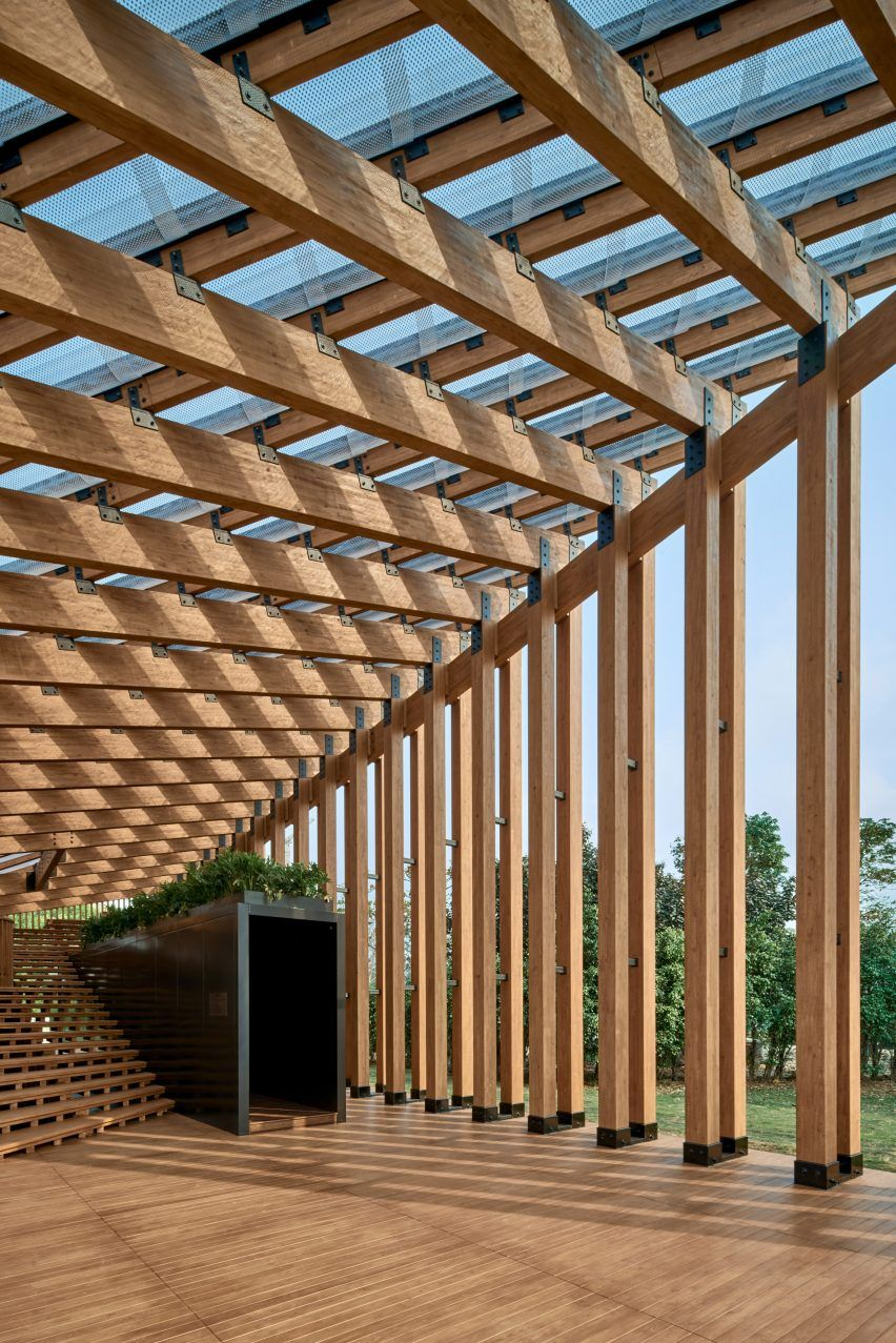 Timber pavilion unifies landscape and waterfront in West Kowloon district