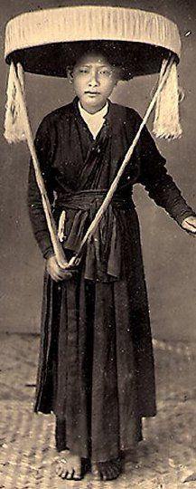 """A Northern Vietnamese woman dressed in """"Ao Tu Than"""" costume."""