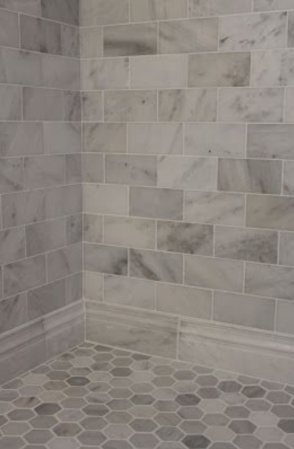 Carrera marble subway tiles and honed marble hexagon floor Images of bathroom tile floors