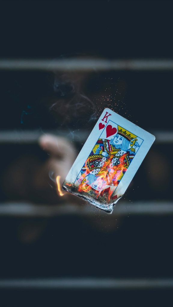 King Of Card Hand Flame Portrait Dark Background 4k Ultra Hd Mobile Wallpaper Hand Of Cards Hd Dark Wallpapers Love Wallpaper Backgrounds