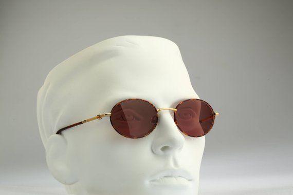 4f02abeff096 Vintage oval sunglasses