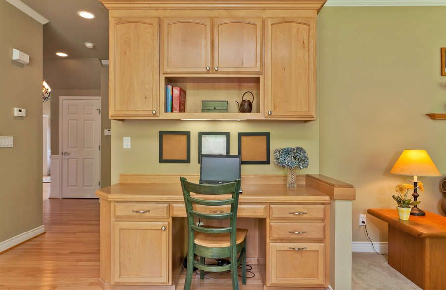 Idea for a desk in the kitchen also notice the white trim for White kitchen cabinets with oak trim