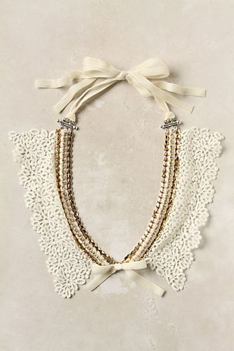 hate this necklace, but like way the ribbon was fastened onto the jewelry components.