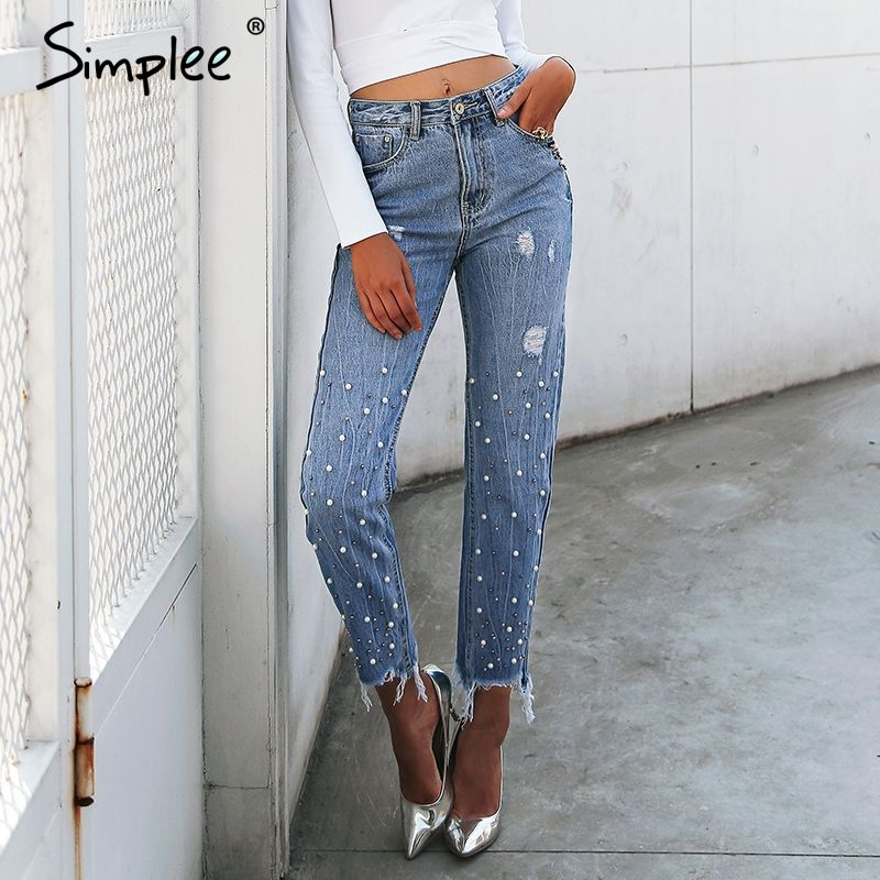 68d8401a7f0 Classy and stylish women s jeans with a ragged bottom and pearls ...