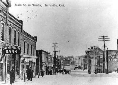 Main Street in Huntsville, Ontario, looking east, in winter, 1907-1920.