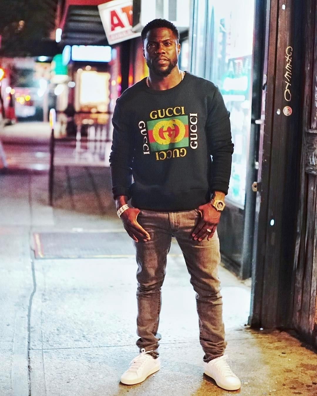 Kevin Hart is wearing a printed sweathsirt from Gucci and a pair of white  shoes from Common Projects dc74a1653