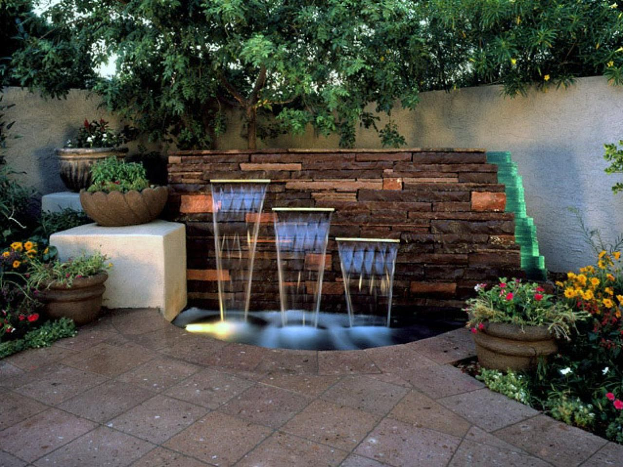 Patio pavers and small pond with outdoor wall fountain for Small garden pond with fountain