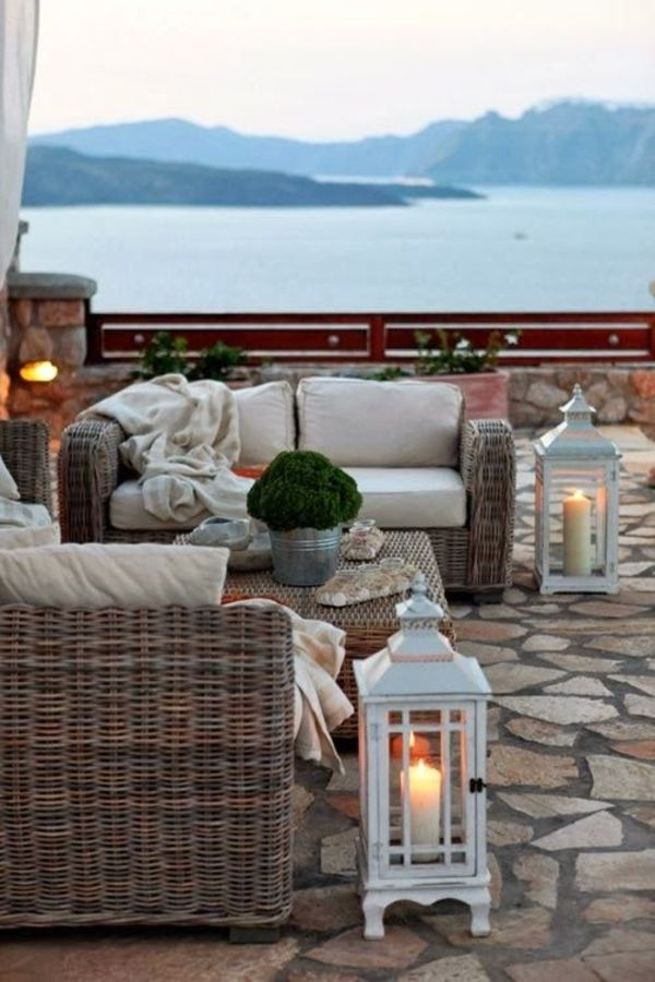 Charming Outdoor Living Room Design In Beach House With Rattan Cahir Sets  And Cool White Candle Light Places On Stone Floor Decoration: Beautiful  Living ...