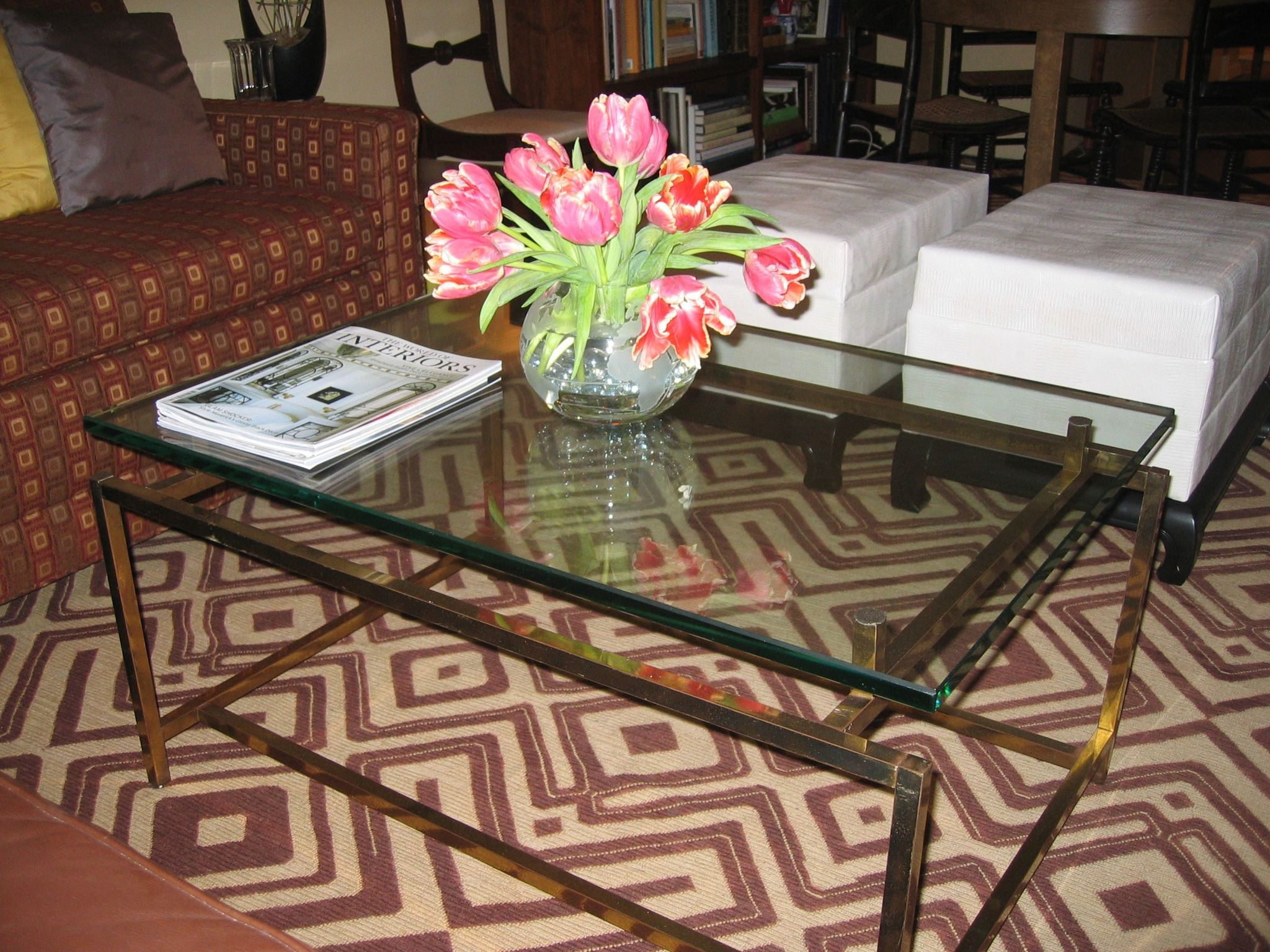 "Floating"" glass coffee table afghan carpet"
