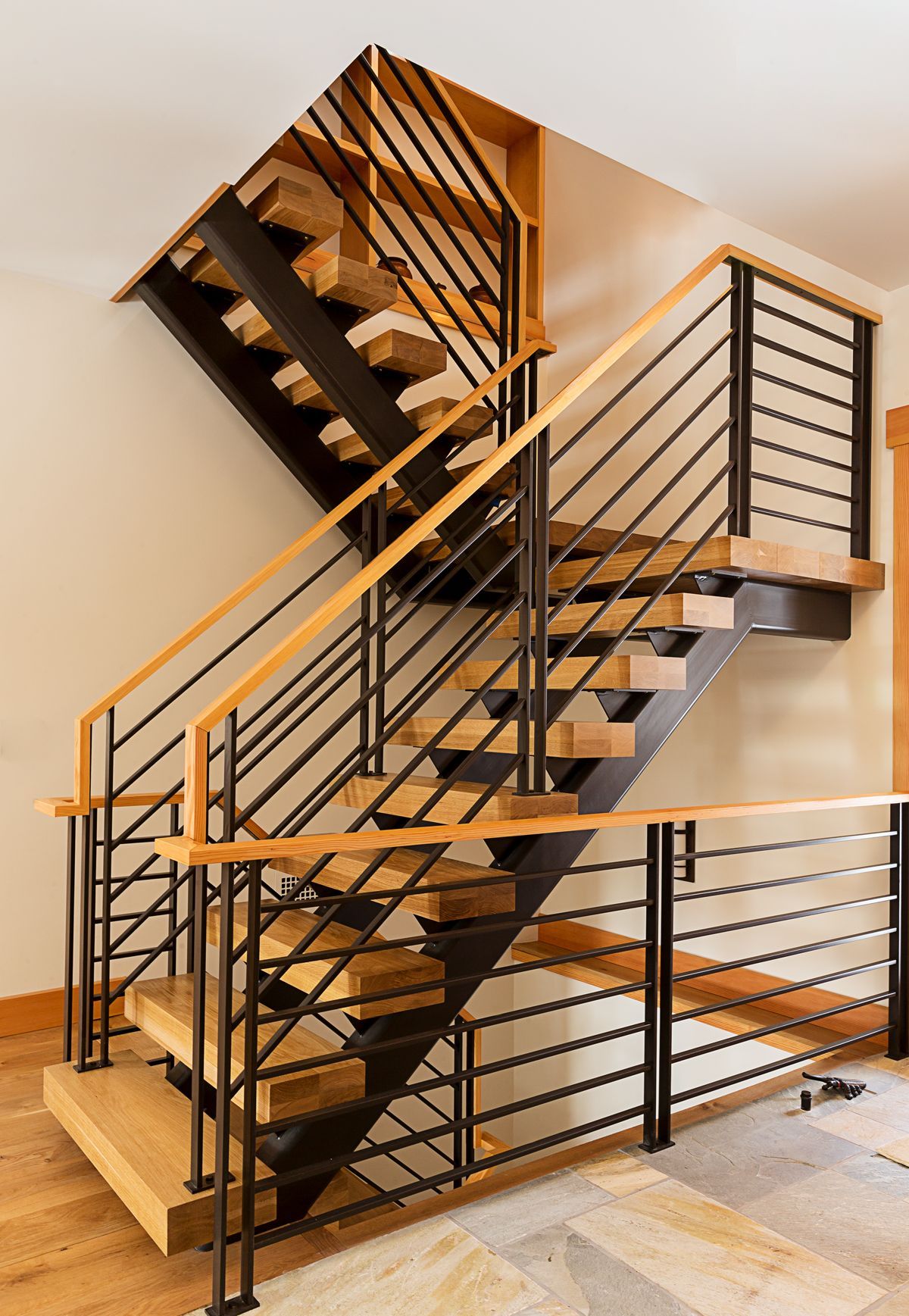 Rustic Modern Wood And Black Metal Staircase By Phinney Design Group Photo By Elizabeth Pedinotti Haynes Stair Railing Stair Railing Design Railing Design