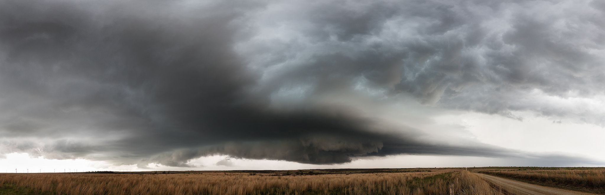 https://flic.kr/p/FnyoJt | Bellevue Supercell Pano | Panoramic version of the supercell that did so much damage in the Dallas / Ft. Worth area on April 12, 2016. We started chasing this storm just south of Wichita Falls just past 2pm. It ended up chasing us for several hours where we had to break off in Chico, TX before it moved into the metroplex. We definitely did not want to get in its path! This storm had grapefruit sized hail! it was incredibly powerful. I feel for all who lost their…