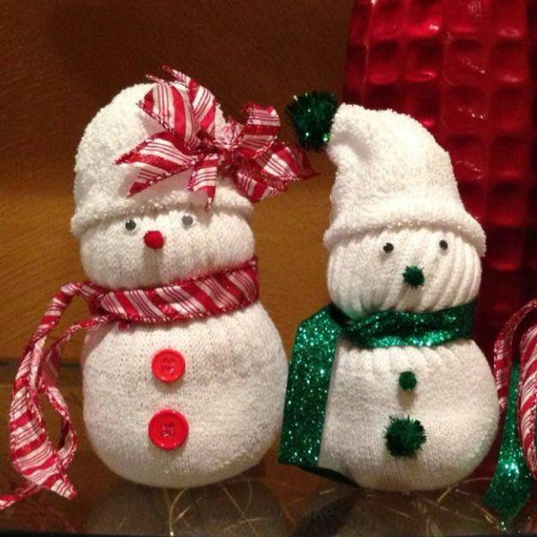 We Re Making These Adorable Snowmen For My Winter Wedding Table Decorations Next Winter But Using R Creative Christmas Crafts Sock Snowman Snowman Decorations