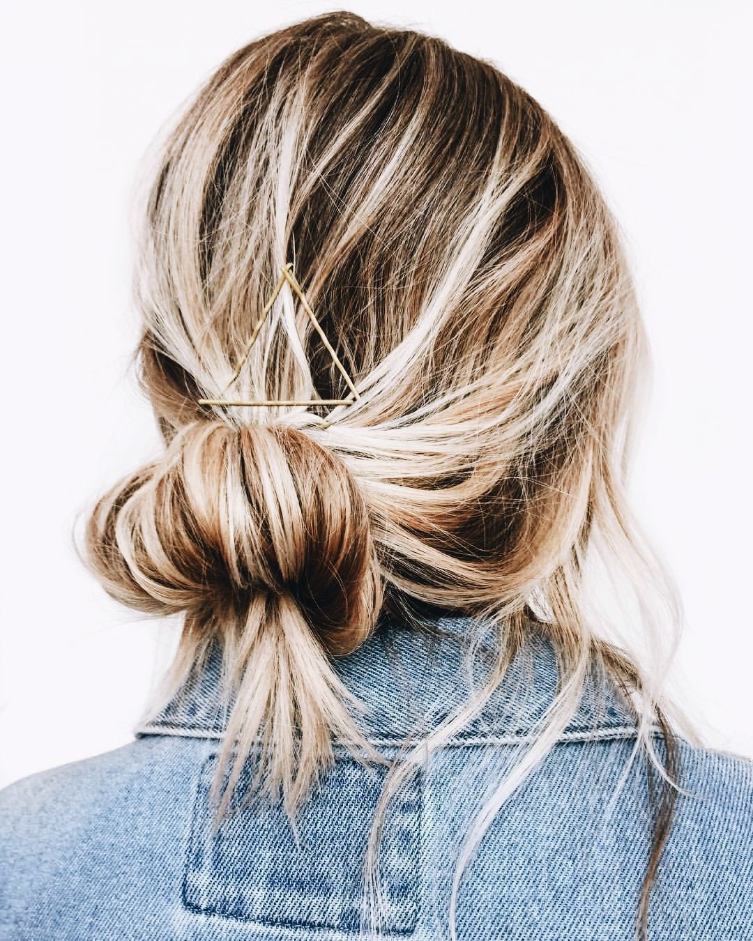 Low messy bun style hair blonde hair easy long hair