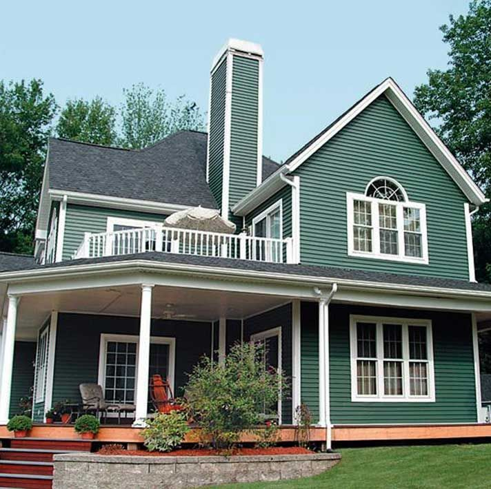 Love This House Not Loving The Color Maybe It S Just The Photo Green Vinyl Siding Green Siding Vinyl Siding House