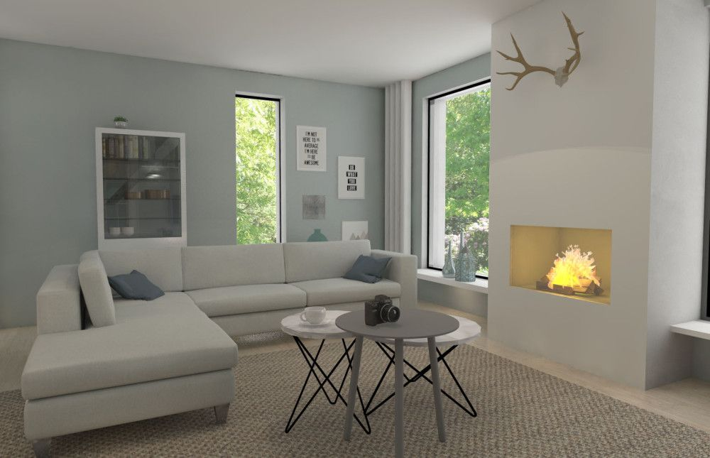 woonkamer huiskamer met grote open haard groene muur en gewei