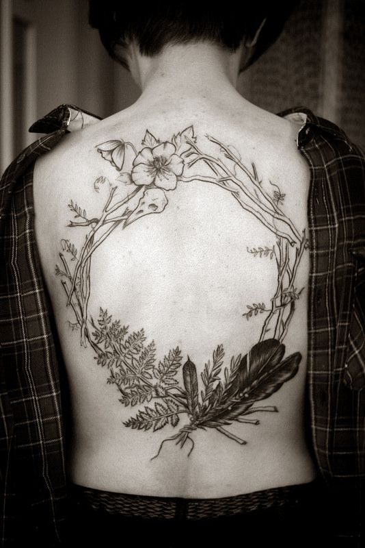 love the twigs n ferns n feathers in this lovely botanical tattoo by Alice Carrier.