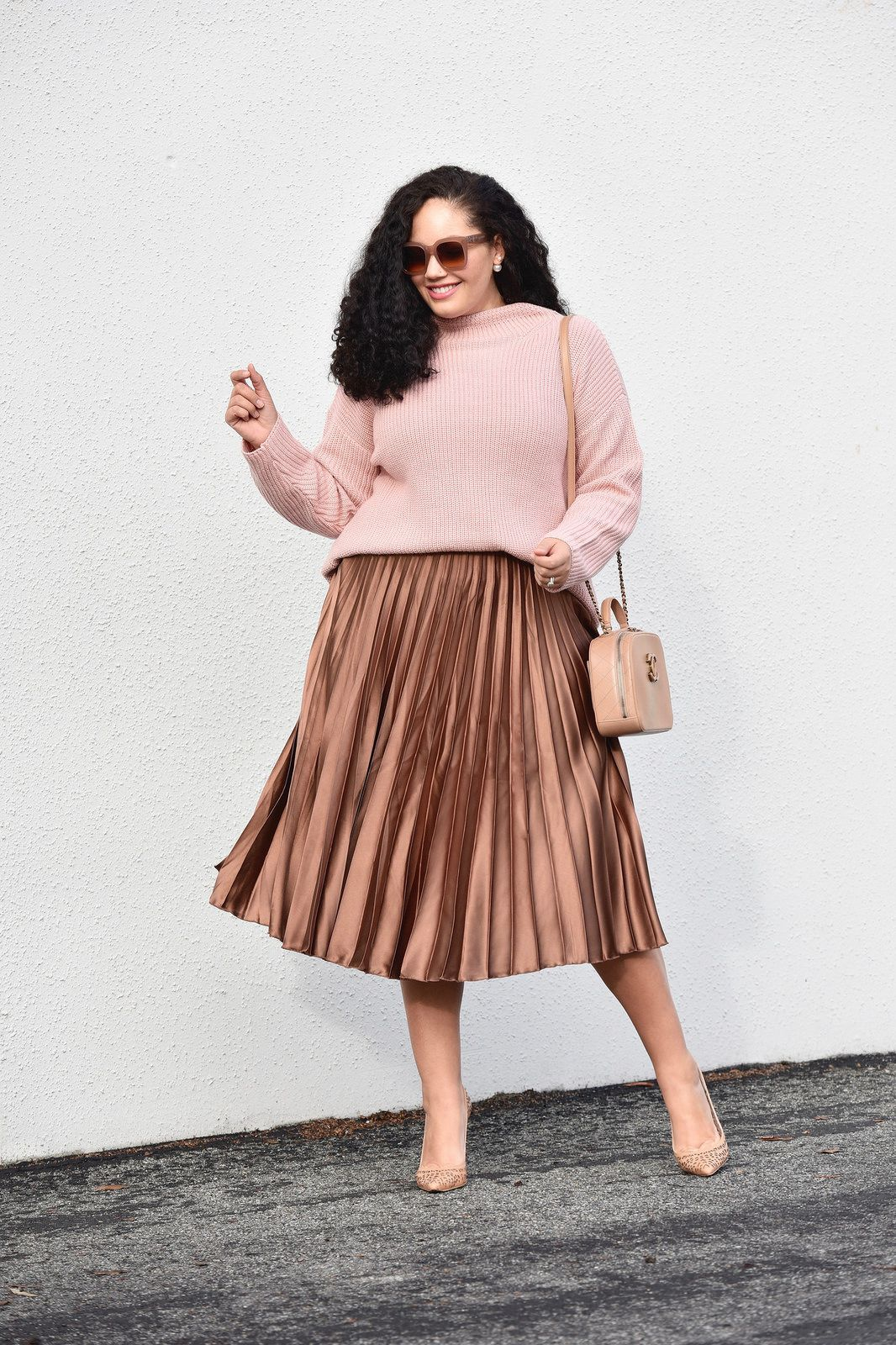 907c8214dd2 Girl With Curves blogger Tanesha Awasthi wearing a pleated Satin Skirt and  sweater.