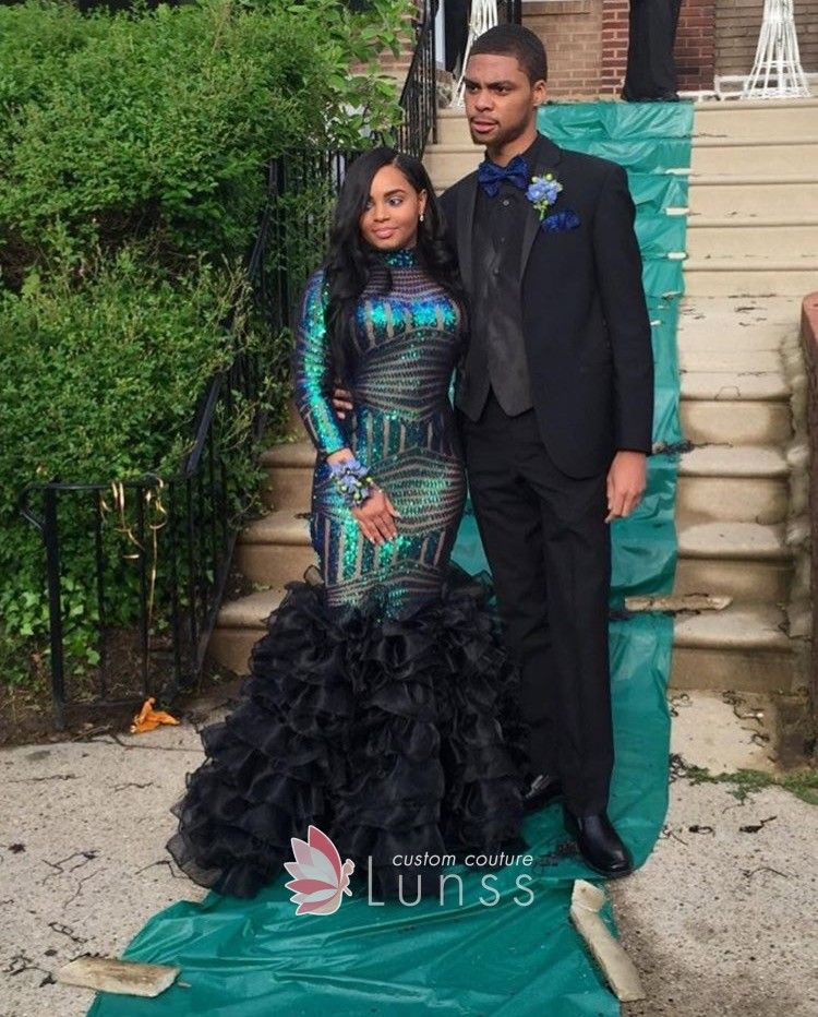 8c6fdc75 Peacock blue sequinned mermaid prom gown for black girls. High neckline  with long sleeves. Ruffled black organza mermaid skirt.
