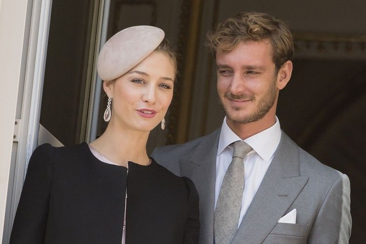 Pierre Casiraghi and his now wife Beatrice exchanging loving glances on the balcony.