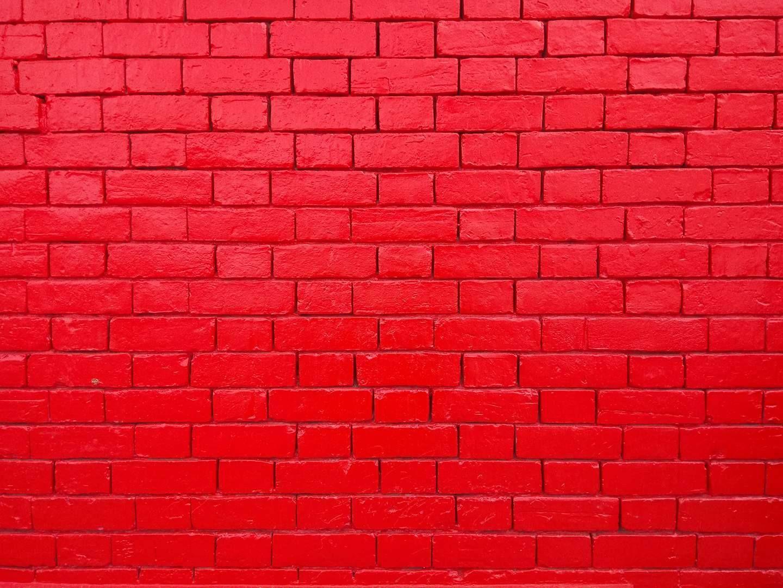 La icónica pared roja de L'atelier Bogotá