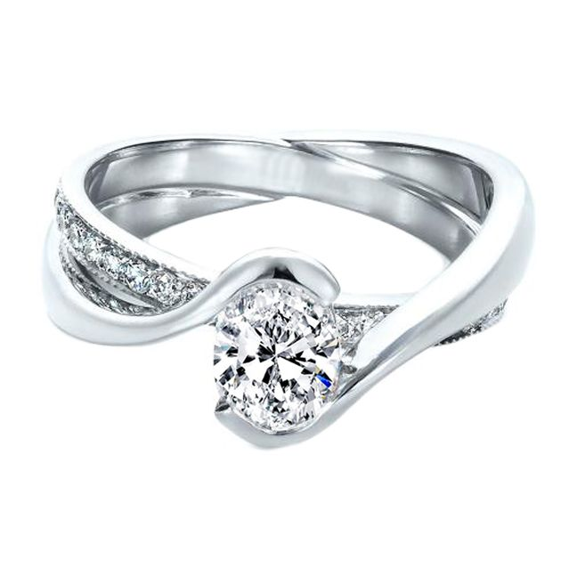 oval twisted criss cross pave engagement ring and