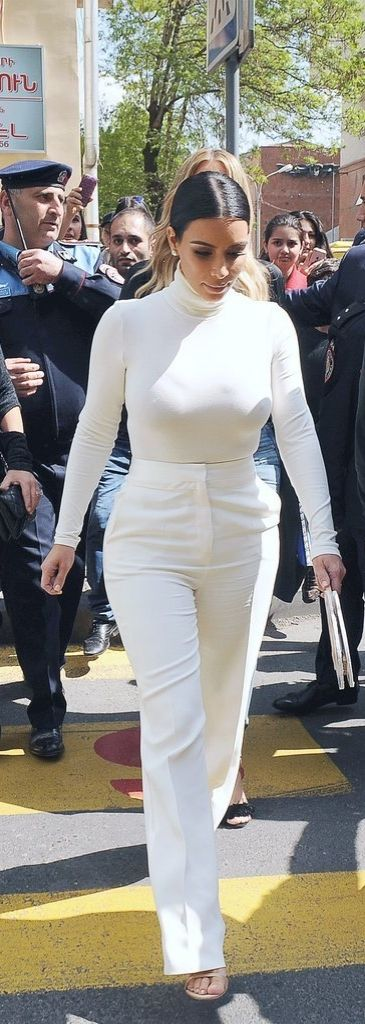 Kim Kardashian covered up in white pants and a matching turtleneck while on vacation in Armenia.