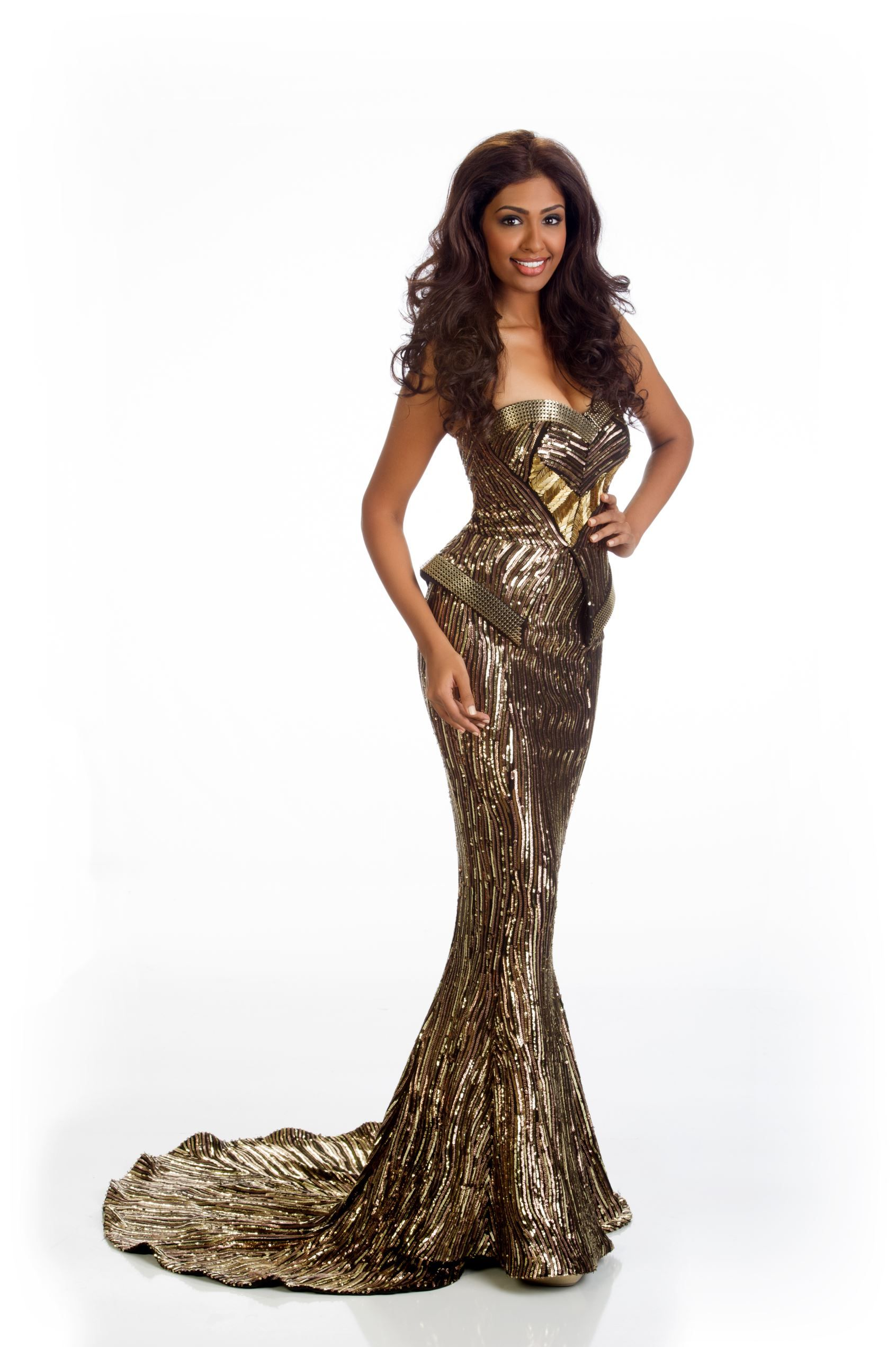 Sabrina Beneett, Miss Malaysia, strikes a pose in this unique black and gold gown.