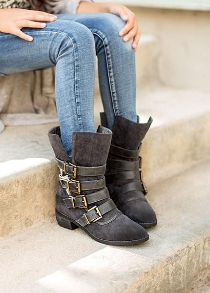 This slouchy boot features rustic strap and buckle details, and an open silhouette for a casual, yet stylish look. With a stacked leather heel and hand distressed finish, this boot is sure to become her favorite. // Heel height: 1