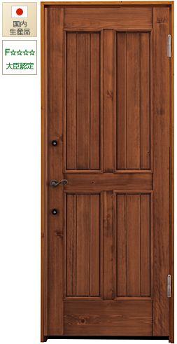 トラディショナルな印象の木製玄関ドア ひのき無垢材でできています