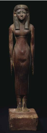 Egyptian wood figure of a lady, Middle Kingdom, early 12th dynasty, 1981-1802…