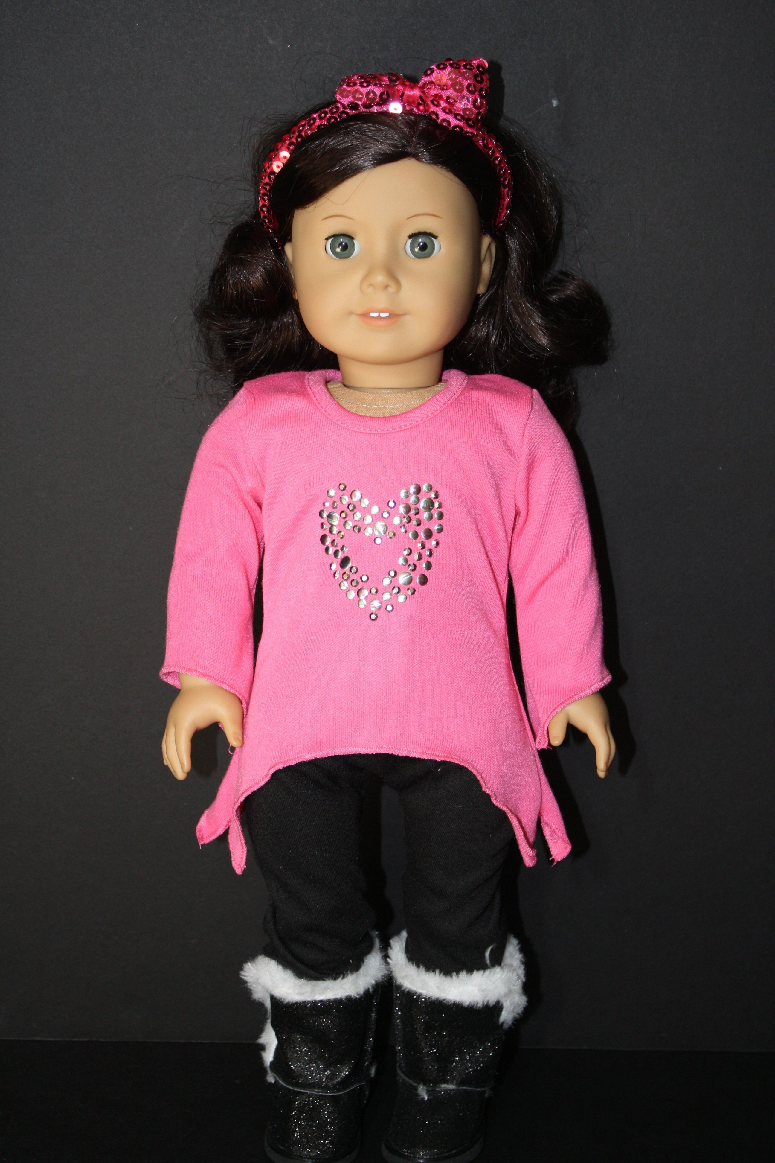Black pants and pink long t style shirt with heart and glitter boots