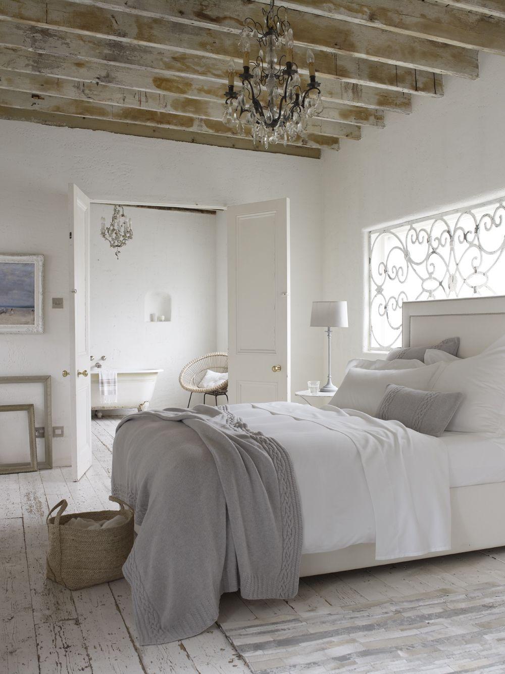 Rustic White Bedroom Suite With Pretty Grey Bedlinen Baskets And Chandelier Home Bedroom Bedroom Inspirations Chic Bedroom