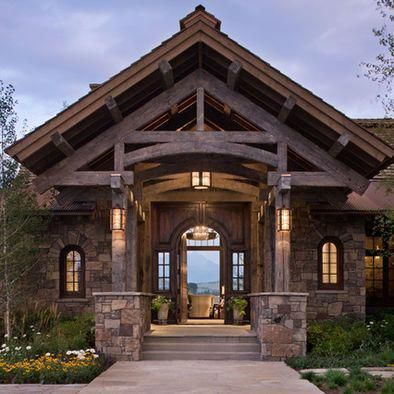 Exterior rustic design like type of rock  entry  out curved beams and smaller rusticlamps also rh pinterest
