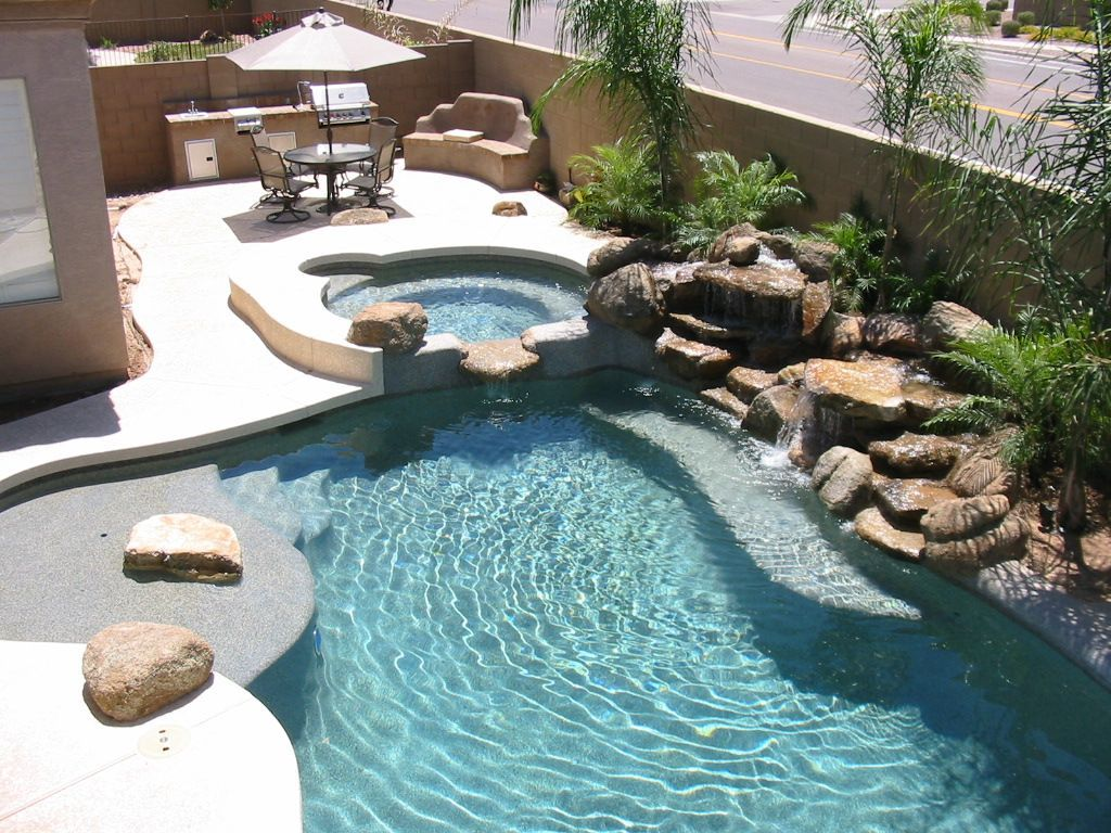 Dont 39 like the stone but the layout works pretty backyard for Landscape design for pool areas