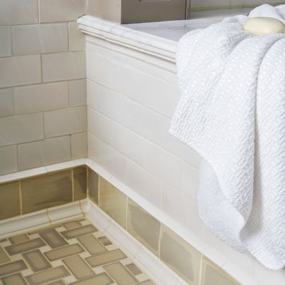 Bath With Floor Tile Subway Between Rows Of Shoe Molding Trim And Knife