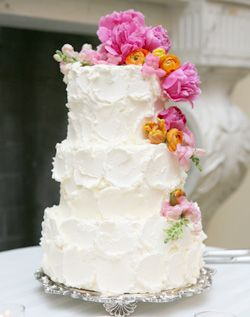 I like the butter cream vs the fondant..minus the pink flowers! Maybe add some edible pearls...