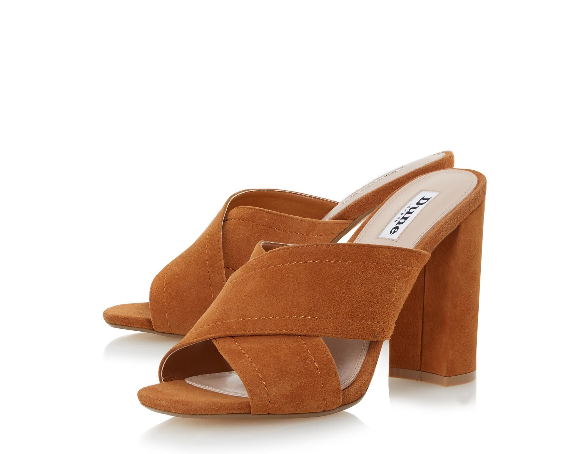 330d03f730fcc0 The classic mule sandal makes another come back for the summer season. This  slip on style features a cross strap vamp and high block heel.