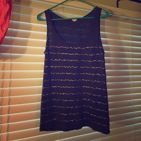 Jcrew sequin tank Navy blue tank with gold and navy sequin stripes. No loose sequin threads. Front pocket detail. Size L. No trades. J. Crew Tops Tank Tops
