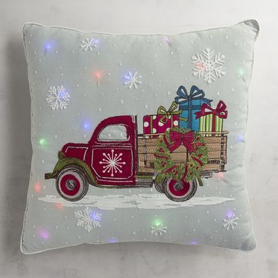 The holidays are on their way! Bring the Christmas lights inside with our charming light-up pillow featuring a vintage truck loaded up with gifts.