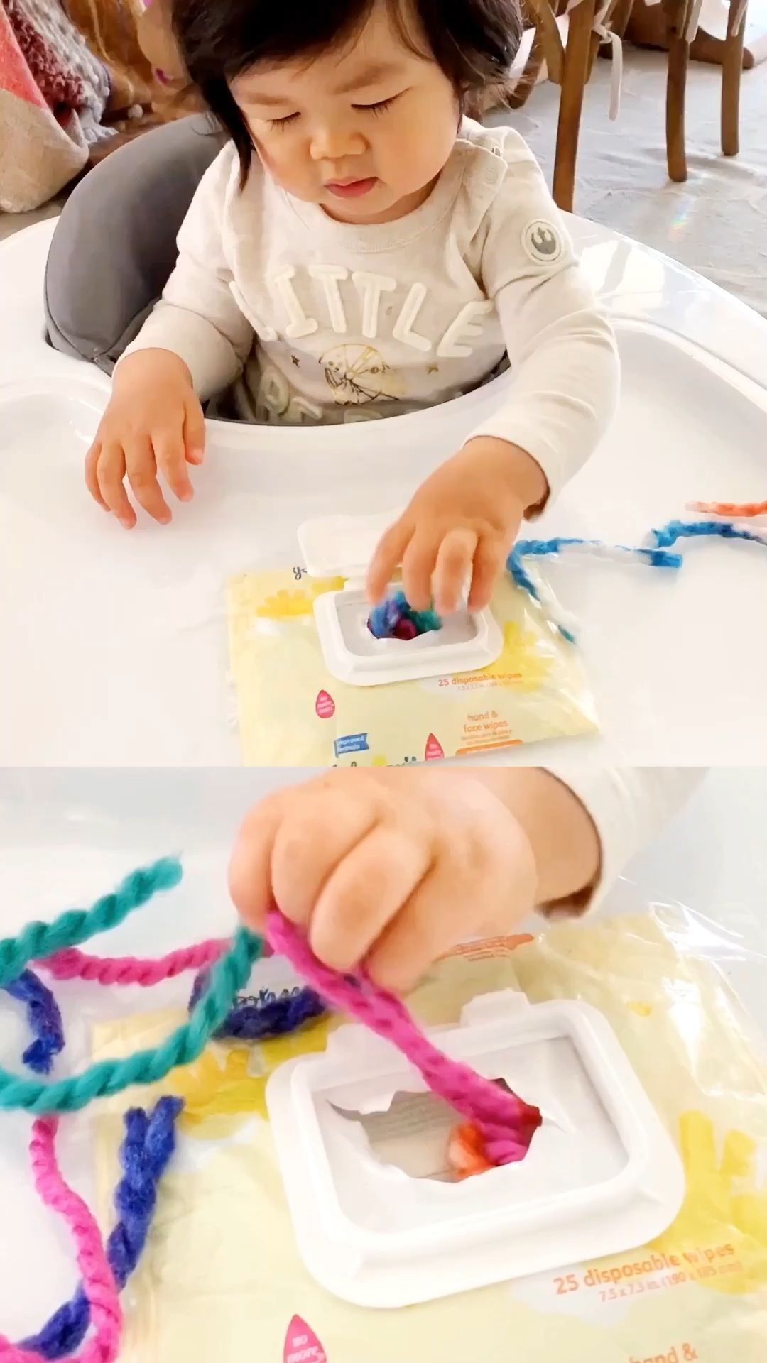Recycle a baby wipe container to set up this easy yarn baby sensory fine motor skills activity
